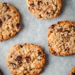 Close up of oatmeal raising cookies on a cookie sheet.