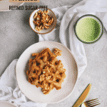 Applesauce waffles with a white napkin and gold silverware.