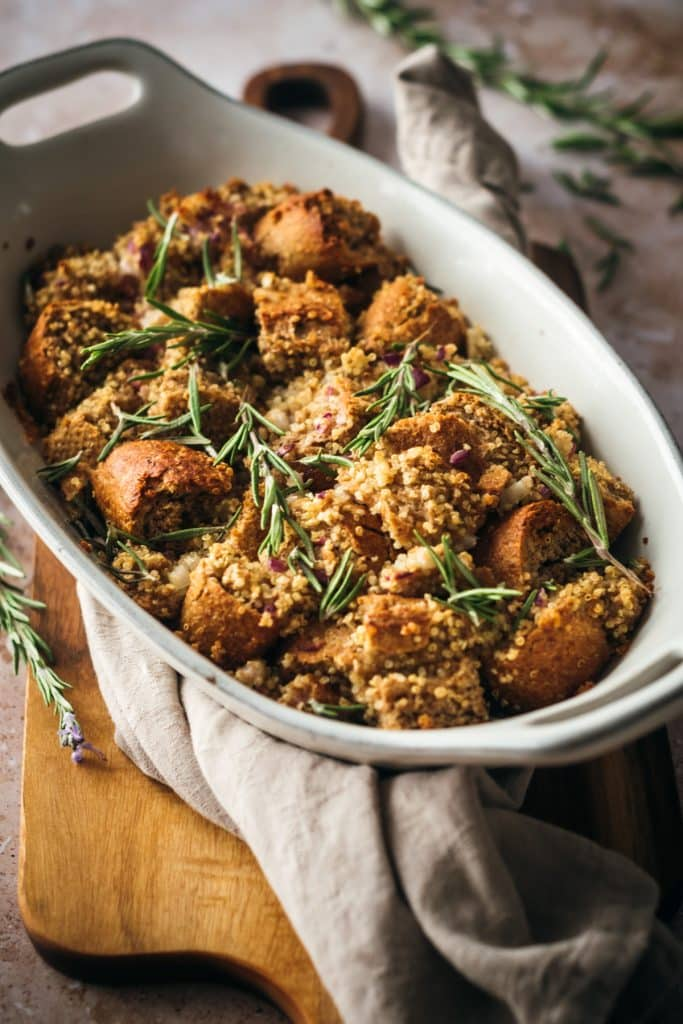 Close up angle of vegan stuffing recipe with fresh rosemary sprigs on top.