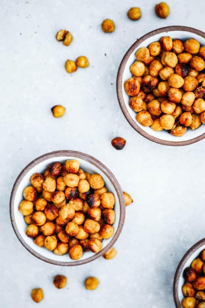 Three bowls of cheesy roasted garbanzo beans.