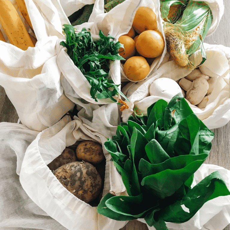Fruits and vegetables in reusable canvas bags