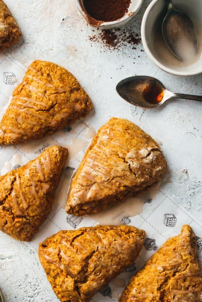 Close up of pumpkin scones with cinnamon glaze drizzle.